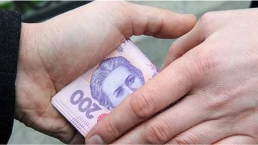 Купував голоси за гроші: на Київщині кандидата у голови ОТГ підозрюють у підкупі виборців